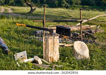 chopper and fuelwood, campfire and food on halt in walking tour
