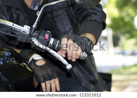 Chopper motorcycle rider hand on the handlebars - stock photo