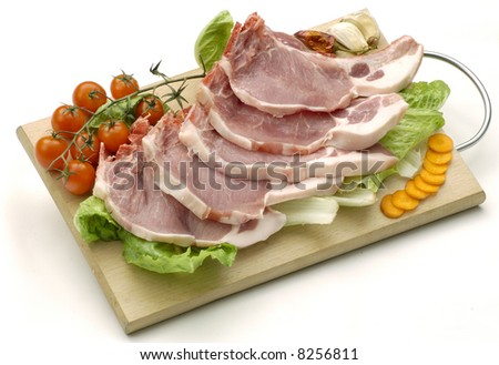 chops on cutting board, isolated on white