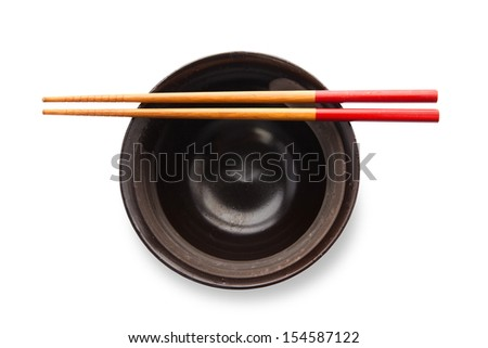 Chopsticks and black bowl isolated on white - stock photo