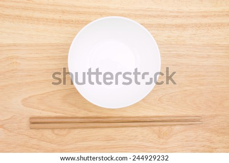 Chopsticks and bowl - stock photo