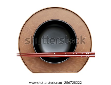 chopsticks and bowl on plate, white background - stock photo