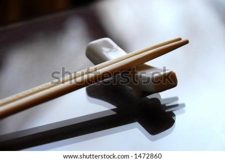 Chopsticks on a holder - stock photo