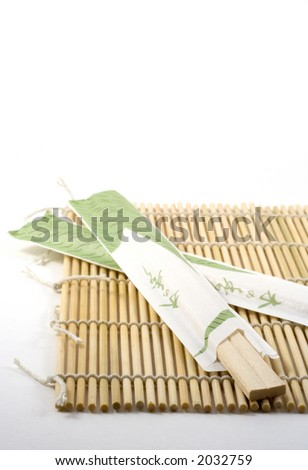 Chopsticks on a Sushi rolling mat