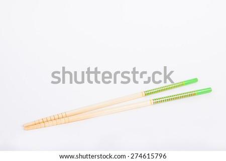 chopsticks on a white paper background - stock photo