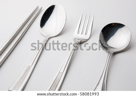 chopsticks spoon and fork stainless steel kitchen utensil isolated