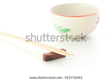 Chopsticks with empty bowl on white background. - stock photo