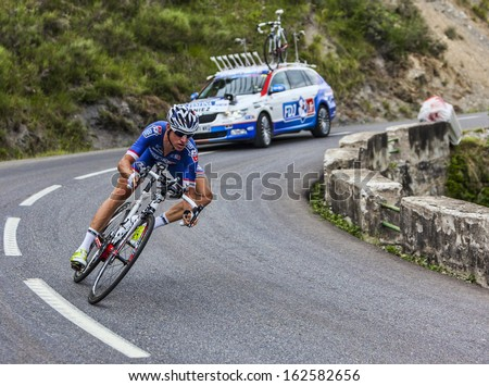 CHORGES, FRANCE- JUL 17:The French cyclist Alexandre Geniez from FDJ.fr Team pedaling during the stage 17 of Le Tour de France 2013, a time trial between Embrun and Chorges on July 17 2013 - stock photo