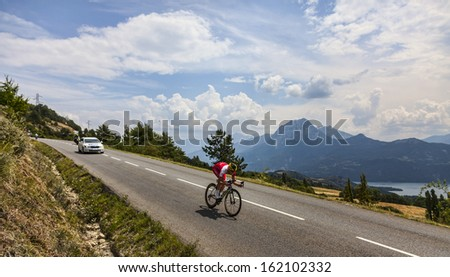 CHORGES, FRANCE- JUL 17:The French cyclist Guillaume Levarlet from Cofidis Team pedaling during the stage 17 of Le Tour de France 2013, a time trial between Embrun and Chorges on July 17 2013 - stock photo