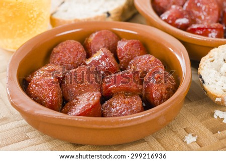 Chorizo a la Sidra - Spanish spicy chorizo sausages cooked in cider. - stock photo