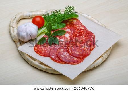 Chorizo sausage - spanish salami on the wood background - stock photo