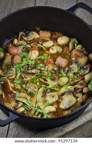 Chorizo Stew with Butter Beans and Mushrooms. Shallow Depth of Field. - stock photo