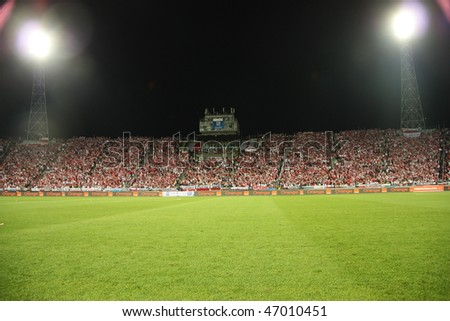 CHORZOW - SEPTEMBER 5: Night image of the Slaski Stadium before the 2010 FIFA World Cup qualifying match between Poland and Northern Ireland on September 5, 2009 in Chorzow, Poland. - stock photo
