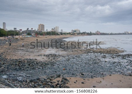Chowpatty Beach at dusk in Mumbai, India - stock photo