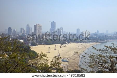 Chowpatty Beach - Mumbai, India. Skyline of Mumbai. Photo taken with a wide-angle lens. - stock photo