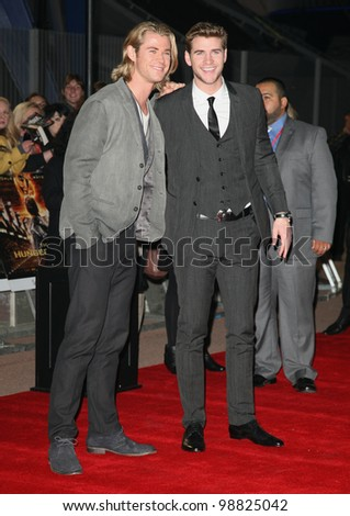 Chris and Liam Hemsworth arriving at the European Premiere of 'The Hunger Games' at the O2 Arena, London. 14/03/2012 Picture by: Alexandra Glen / Featureflash - stock photo