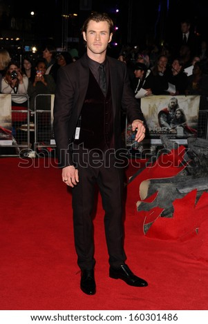 "Chris Hemsworth arrives for the world premiere of ""Thor: The Dark World"" at the Odeon Leicester Square, London. 22/10/2013 - stock photo"