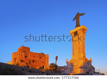 Christ Monument in front of the Monastery on the top of El Toro Mountain - the highest peak of Menorca, Balearic Islands, Spain - stock photo