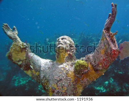 Christ statue with coral seafan backdrop.This statue sits outside of Key Largo, Florida facing a sister statue located off the coast of Italy.