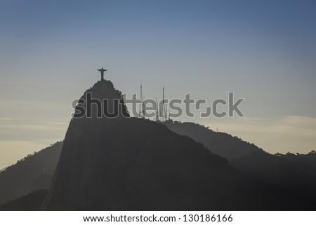 Christ the Redeemer at sunset in Rio de Janeiro, Brazil - stock photo