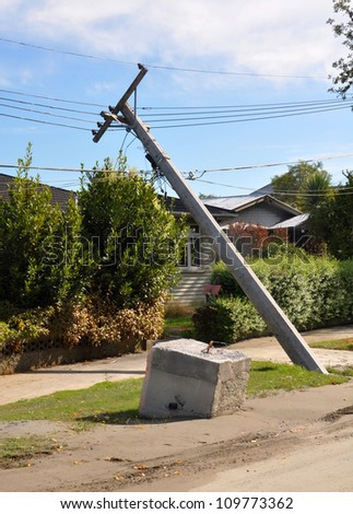 CHRISTCHURCH, NEW ZEALAND - FEBRUARY, 24: Earthquake liquefaction causes power polls and cables to collapse on February 24, 2011 in the Christchurch suburb of Avonside. - stock photo