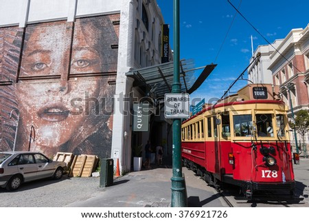 CHRISTCHURCH, NEW ZEALAND - FEBRUARY 15, 2016: Historic tram beside street art mural.