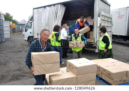 CHRISTCHURCH, NEW ZEALAND, FEBRUARY 22, 2011 - Volunteers unload food for victims of the 6.4 earthquake in Christchurch, South Island, New Zealand, 22-2-2011 - stock photo