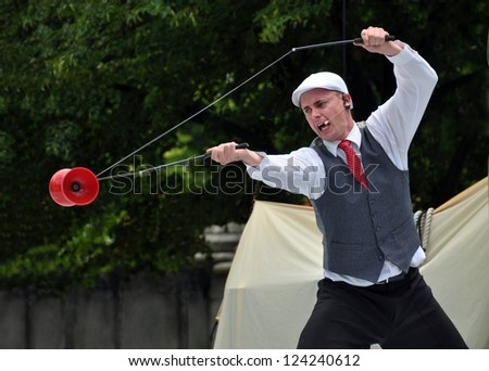 CHRISTCHURCH, NEW ZEALAND - JANUARY 22, 2011: Australian performer Asher Treleaven juggling a red Diablo at the at the 18th World Buskers Festival on January 22, 2011 in Christchurch. - stock photo