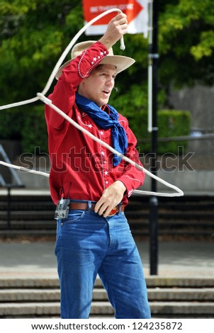CHRISTCHURCH, NEW ZEALAND - JANUARY 23, 2011: Texas entertainer Shelby Bond, also known as Cowboy Max, performing at the at the 18th World Buskers Festival on January 23, 2011 in Christchurch. - stock photo