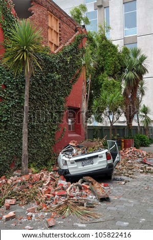 CHRISTCHURCH, NEW ZEALAND - MARCH 12: A car is crushed by a collapsed brick wall on March 12, 2011 in Christchurch following a 6.2 magnitude earthquake. - stock photo