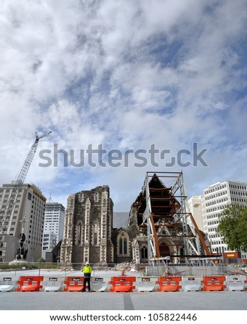 CHRISTCHURCH, NEW ZEALAND - MARCH 10: Panoramic view of the ruins of the Anglican Cathedral on March 10, 2012 in Christchurch. In the background cranes dismantle remaining office blocks in the CBD. - stock photo