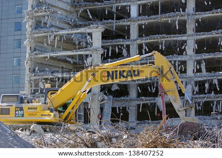 CHRISTCHURCH, NEW ZEALAND, NOVEMBER 16:  An excavator continues demolitions in earthquake ridden Christchurch, New Zealand, 16-11-2012. - stock photo