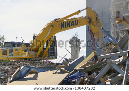 CHRISTCHURCH, NEW ZEALAND, NOVEMBER 16:  An excavator continues demolitions in earthquake ridden Christchurch, New Zealand on 16-11-2012. 182 people died in the 6.4 earthquake the previous year.