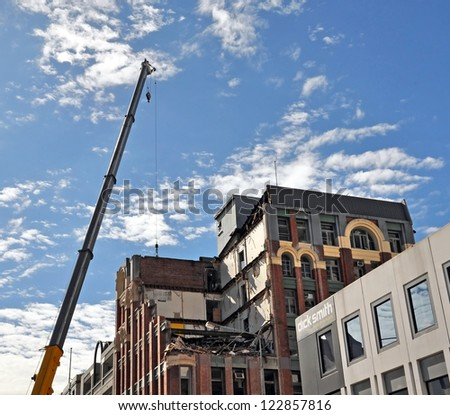 CHRISTCHURCH, NEW ZEALAND - NOVEMBER 11, 2010: Demolition of the historic 7 story MLC building at 161 Manchester street is underway after recent earthquakes on November 11, 2011 in Christchurch. - stock photo
