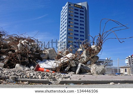 CHRISTCHURCH, NEW ZEALAND, NOVEMBER 16, 2012 - Piles of earthquake rubble remain in Christchurch, South Island, New Zealand, 16-11-1012 - stock photo