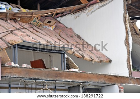 CHRISTCHURCH, NEW ZEALAND, SEPTEMBER 4, 2010 -  A table survives the wreckage of the first big earthquake in Christchurch, New Zealand, 4.9.2010. - stock photo
