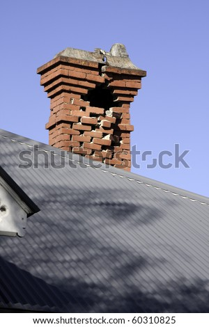 CHRISTCHURCH, NEW ZEALAND- SEPTEMBER 4:  Image of part of a collapsed chimney caused by earthquake on Sept 4, 2010 in Christchurch.  The 7.1 earthquake hit at 4:35am - stock photo