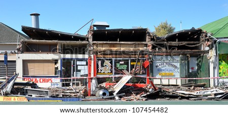 CHRISTCHURCH, NEW ZEALAND - SEPTEMBER 05: Two takeout  food shops and a hairdressing salon are destroyed by a huge earthquake on September 05, 2010 in Christchurch. - stock photo