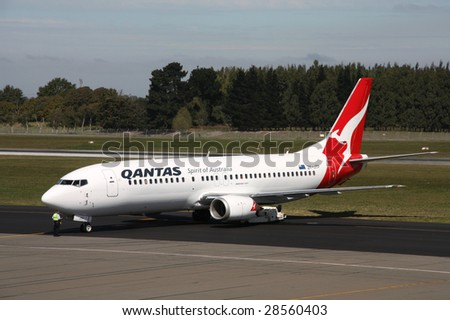 CHRISTCHURCH, NZ - MARCH 18: Qantas Jetconnect aircraft taxis March 18, 2009 at Christchurch Airport. On April 15 Qantas announced the deferment of new aircraft delivery due to the financial crisis. - stock photo