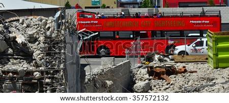 CHRISTCHURCH,  NZL - DEC 04 2015:Christchurch tour bus in downtown Christchurch.The bus tours the city thorough Christchurch landmarks and earthquake destruction sites. - stock photo