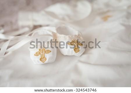 Christening textile booties - stock photo