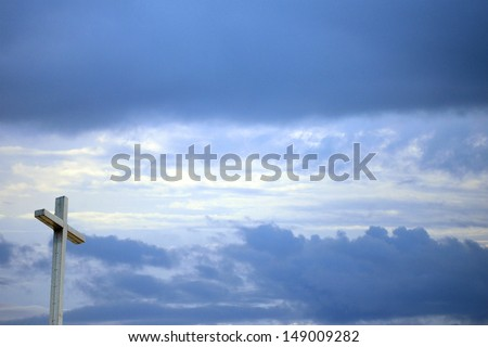 Christian background with cross sun shining through and sky - stock photo