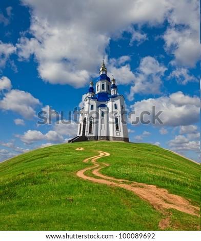 christian church on a green hill - stock photo