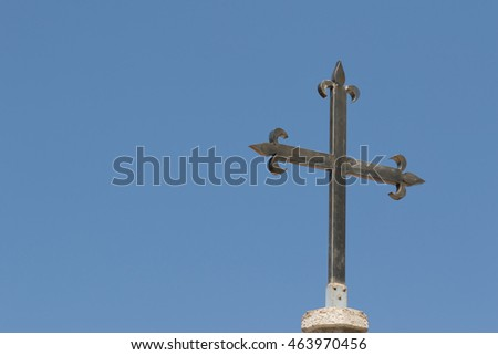 Christian cross in front of blue sky