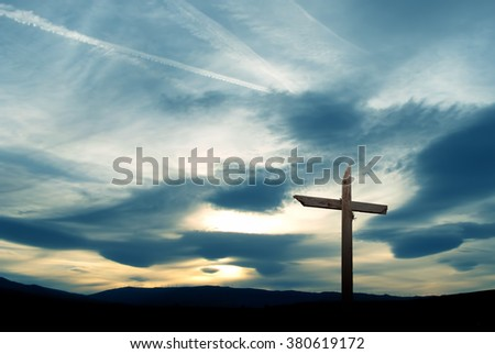 Christian cross made of wood over beautiful sky background - stock photo