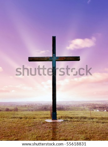 christian cross of christ at sunset or sunrise