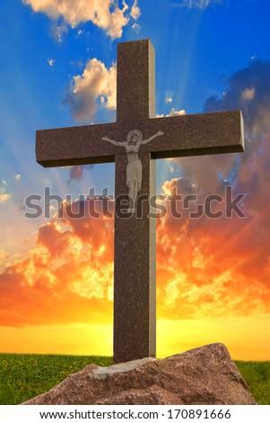 christian cross on a sunset background - stock photo