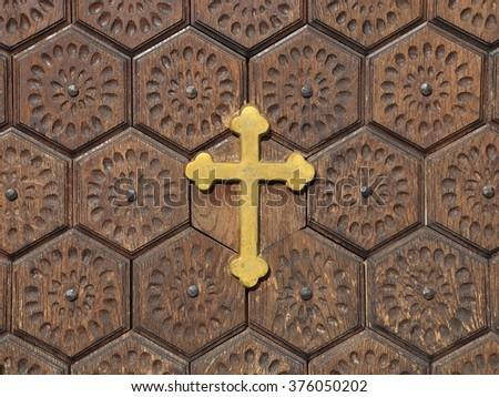 Christian cross on a wooden door - stock photo
