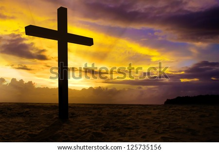 christian cross on sunset background - stock photo