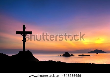 christian cross on sunset background  - stock photo